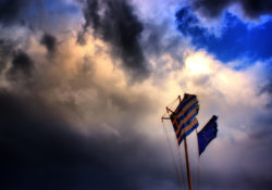 Greek flag in dark blue sky
