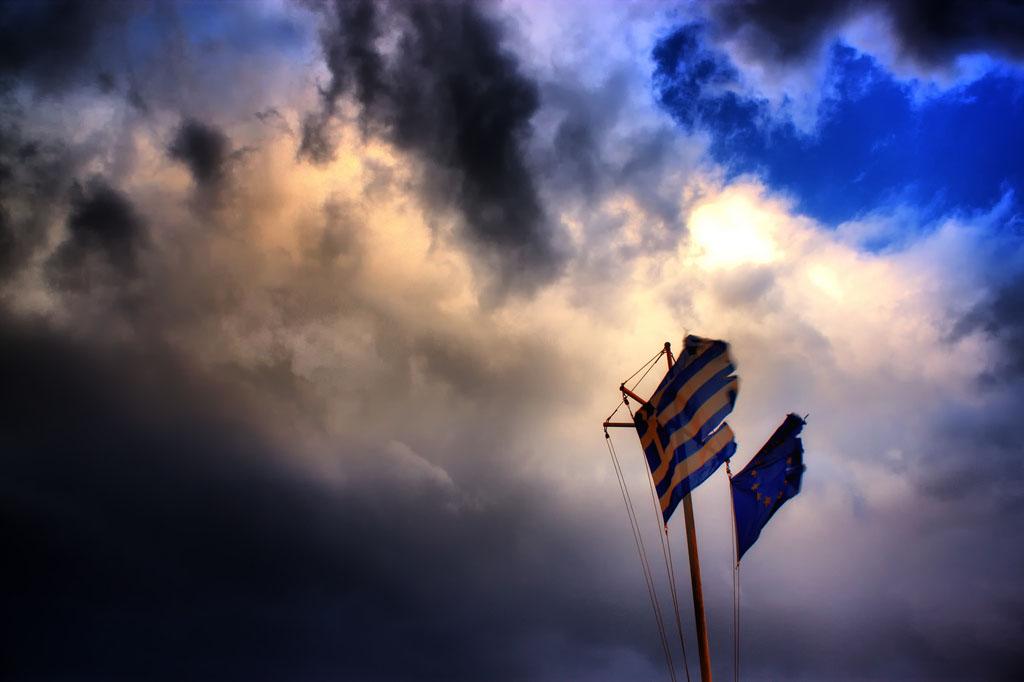 Greek flag in dark blue sky